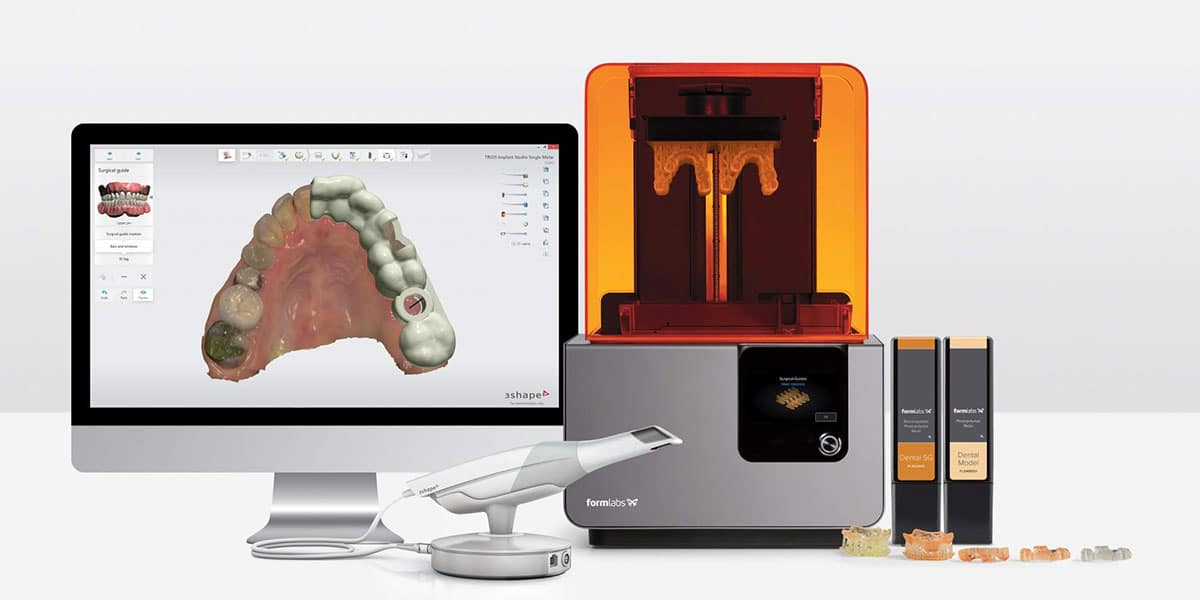 Digital Intraoral Scanner in front of monitor with digital impression